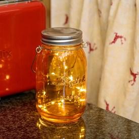 Barattolo in vetro arancio, h 15 cm, 15 microled bianco caldo, batteria