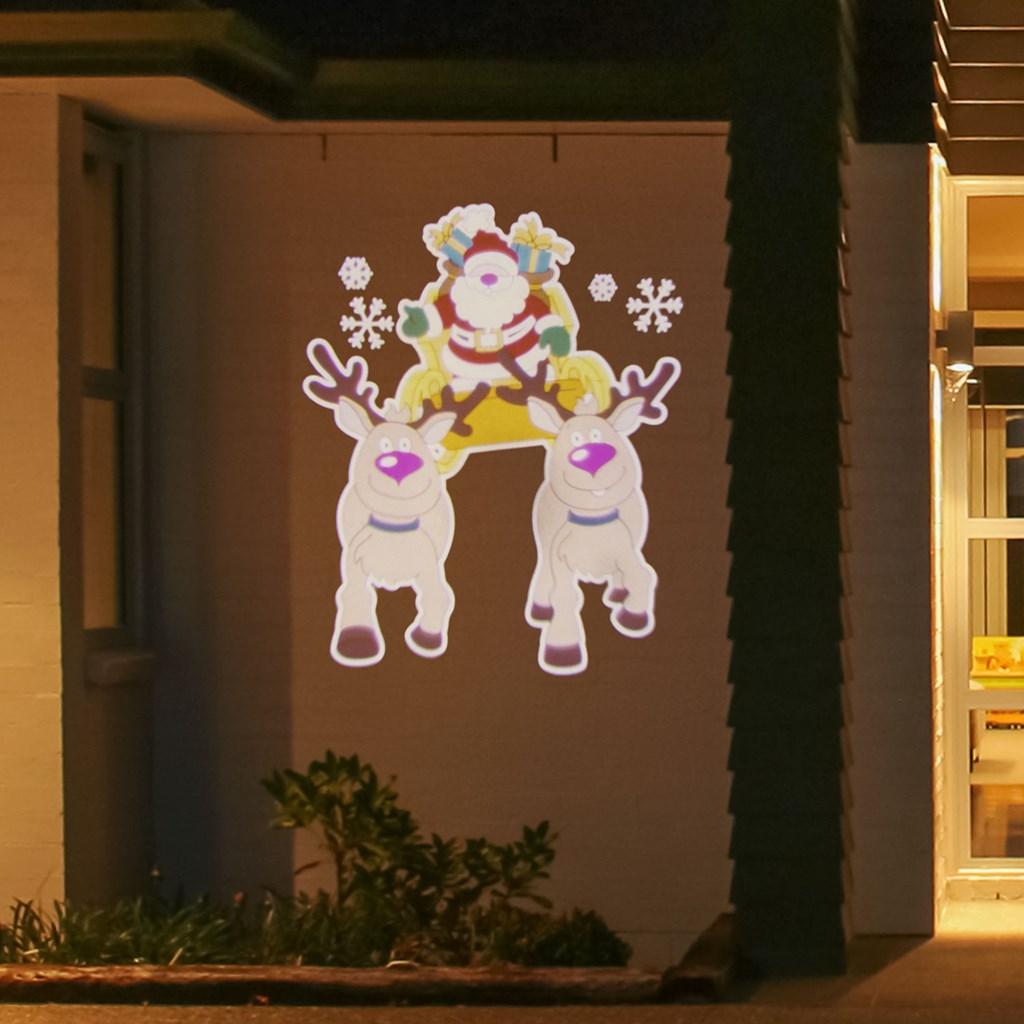 f6f60d20246 Proyector navideño Led musical Papá Noel en trineo efecto movimiento ...